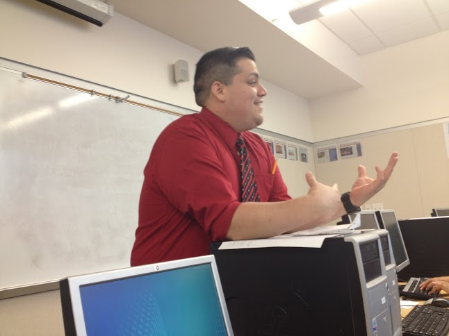 A teacher speaking to his class about school.