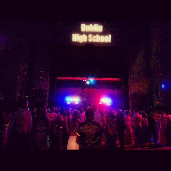 Students gather on the dance floor with lights flashing and music blasting