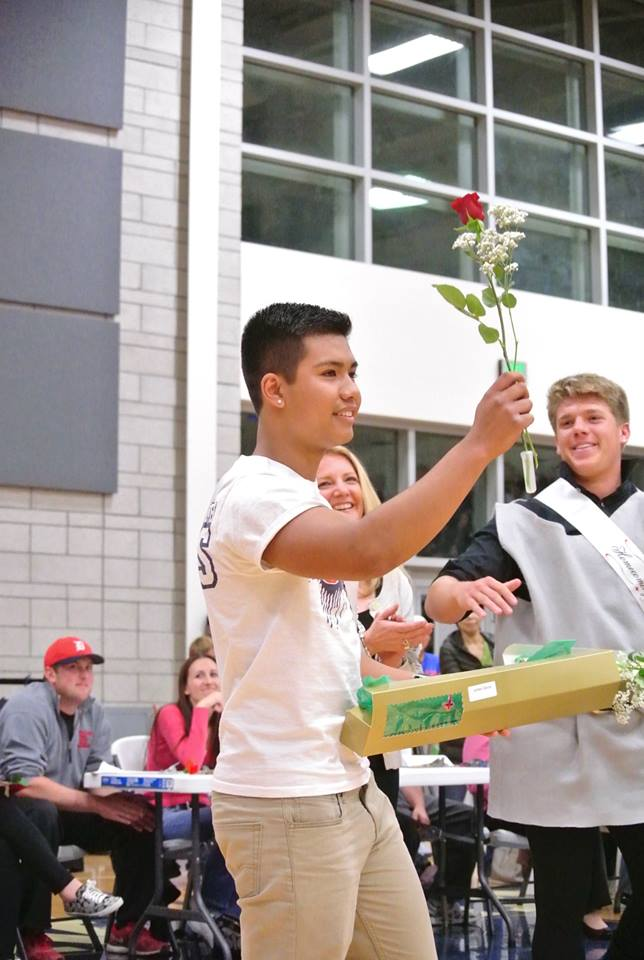 Jordan Garcia taking out the red rose from his box and winning homecoming king.