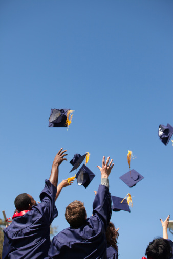 In the picture above, students are throwing their caps in excitement upon their graduation.