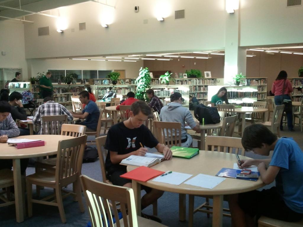 ABOVE%3A+Students+early+in+the+morning+finishing+homework+in+the+library.