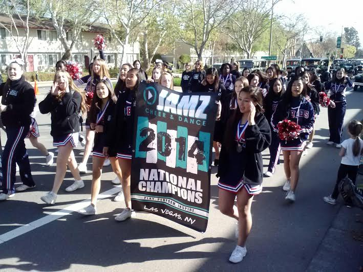 ABOVE: The DHS Cheerleaders walking in the parade. Credit: Annette Martinez