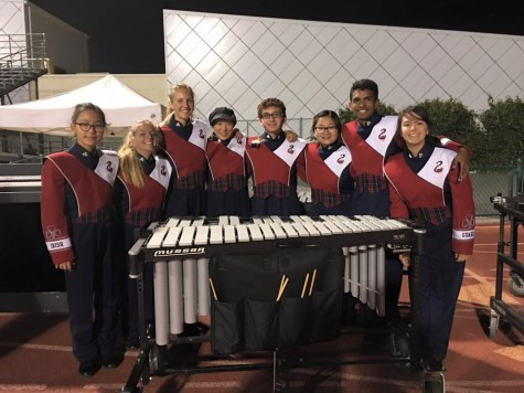 The Front Ensemble at the competition. In order from left to right: Jiwon Han, Carly Koch, Alyssa Kaatmann, Laura Wang, John Lonergan, Winnie Xu, Akshit Annadi, Payton Chow. Photo credits to Laura Wang.