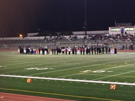 Drum majors and color guard captains from each school stand in anticipation during the awards ceremony