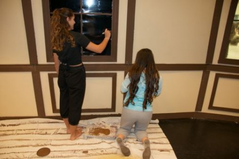 """Painting the set of """"Fools"""". Putting on plays is a team effort."""