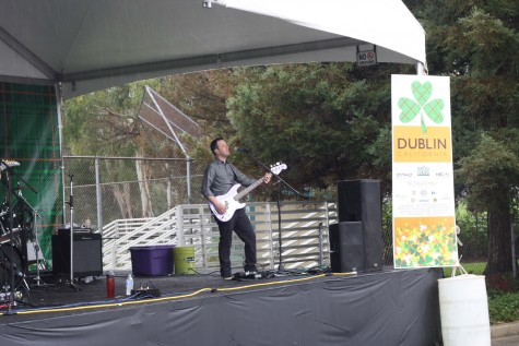 "The band ""Zoo Station"" singing classic ballads for the audience in the rain. The weekend hosted many bands including ""I Eyed Reilly"", ""Avalon Rising"", ""The Kavanaugh Brothers"", and ""Rogue Rebellion""."