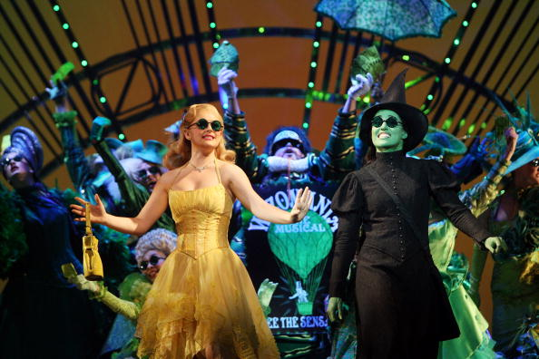 MELBOURNE, AUSTRALIA - JULY 11:  Lucy Durack performs as Glinda, the Good Witch and Amanda Harrison performs as Elphaba, the Wicked Witch during a photo call for