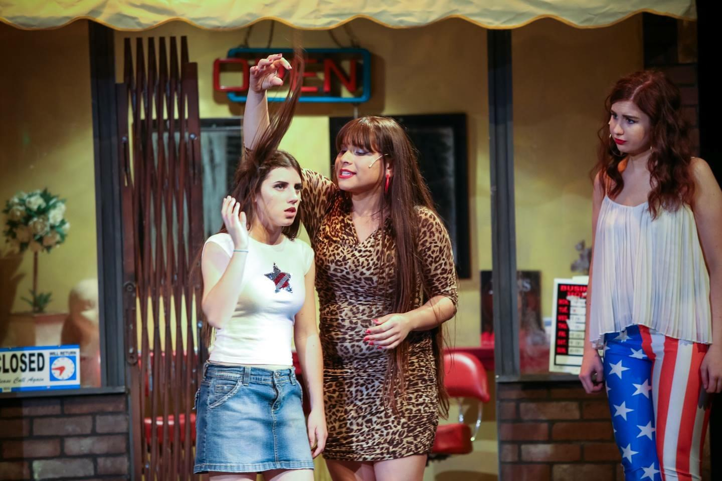 "Simone Campos (right) as Danielle in last year's spring musical ""In the Heights"". Along with Venessa (left, played by Kieva Bradley) Daniele ran a salon in the Washington Heights neighborhood where the play was set."