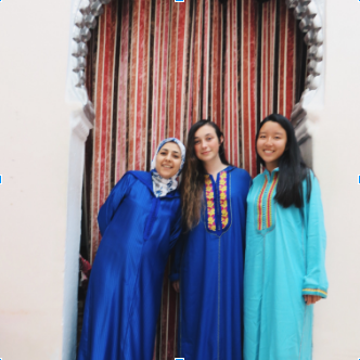 Leesa's host mom (left), roommate (middle), and Leesa (right) dressed in djellabas, a type of traditional Moroccan clothing, on Eid al-Fitr