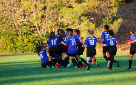 After they won, the entire team ran to a big group hug, which ended up with everyone laughing on the ground.