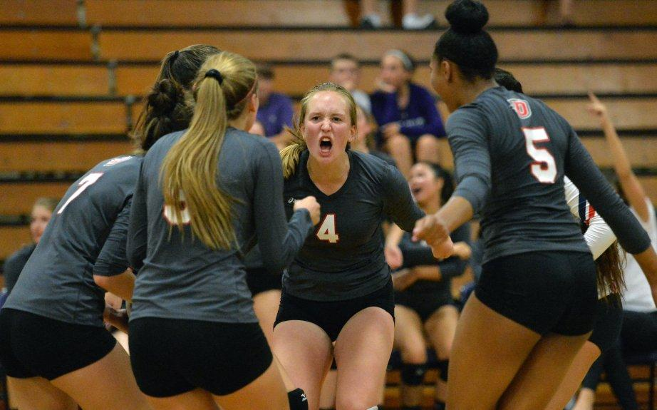 Members of the Dublin High volleyball team celebrate a point during their match against Amador Valley High in Pleasanton, Calif., on Thursday, Sept. 15, 2016. (Doug Duran/Bay Area News Group)