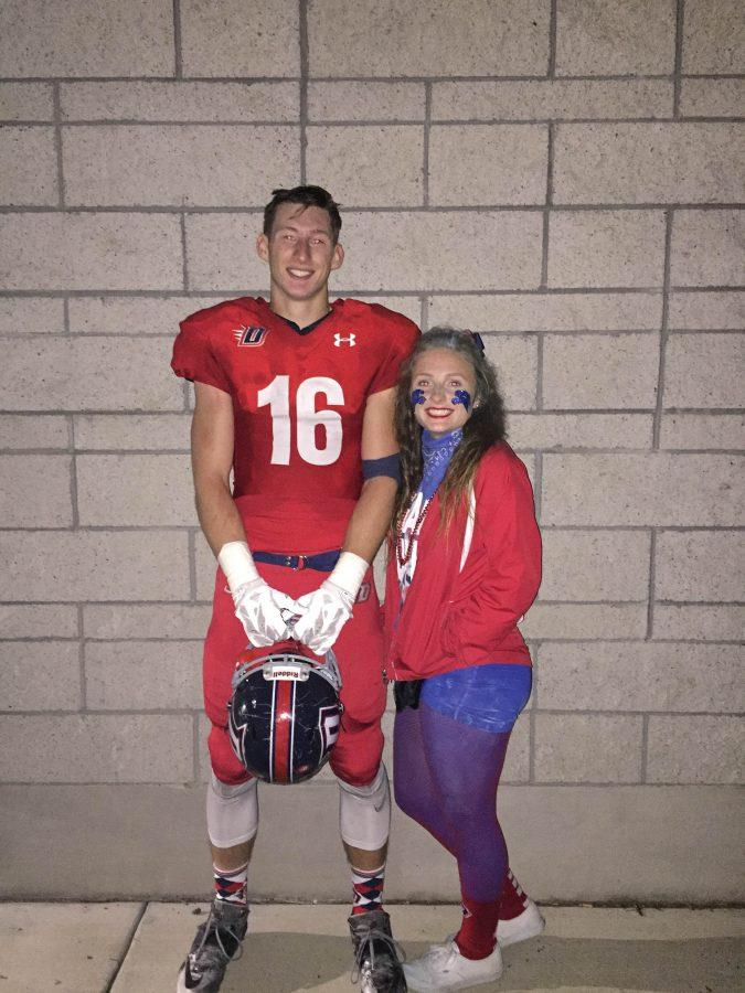 Senior football player Trevor Helmuth and ASB president Jenny Dyer take a picture after  Senior Night.