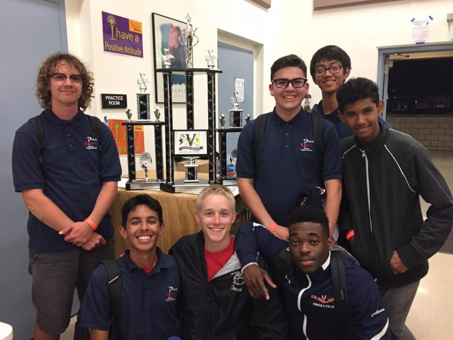 The battery section took a photo with the three trophies that Dublin High School brought home! Front row: Pranav Singh, Jacob Bratsman, Piat Coulbourne Back row: Zach Larson, Zachary Scharton, Benjamin Ly, Adam Ganeshalingam  CREDITS: Laura Morphis Larsen