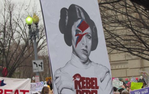 Carrie Fisher's legacy as strong-willed Princess Leia was honored at the Women's March on D.C. in marcher's signs.