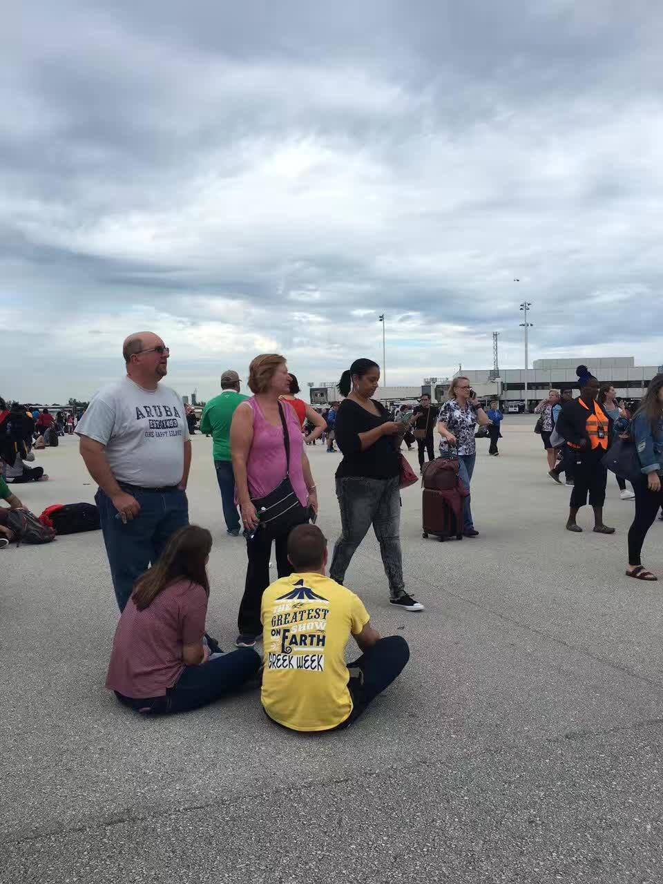 Anxious people await at the Fort Lauderdale Airport after the shooting.