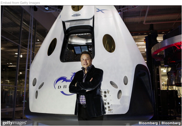 Elon Musk, CEO of Space Exploration Technologies Corp. (SpaceX), stands for a photograph at the unveiling of the Manned Dragon V2 Space Taxi.