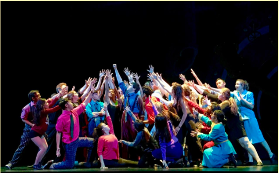 "The cast of Guys and Dolls strike a pose at the end of the musical number ""Crapshooter's Dance."""
