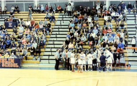 Students at a basketball game.