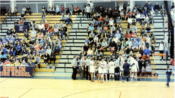 Students at a basketball game.