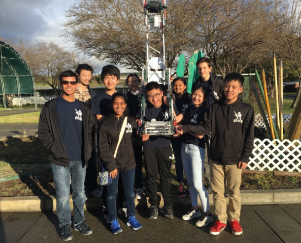 5327C poses with their robot after qualifying to worlds at NorCal States.