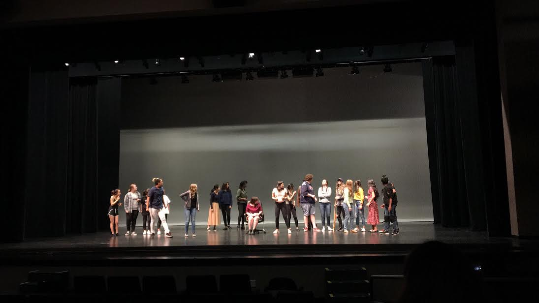 The cast rehearsing from the perspective of an audience member.