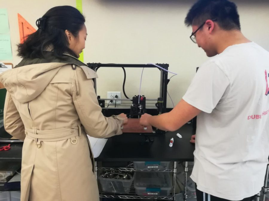 Ms. Chou helps student Wesley Wong with an engineering project that requires classroom equipment, just one example of the projects that longer block periods could enable.