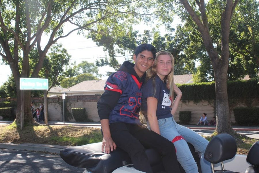 Shane and Kailee, the winners of the Homecoming proposal contest, had a great time riding in the parade.