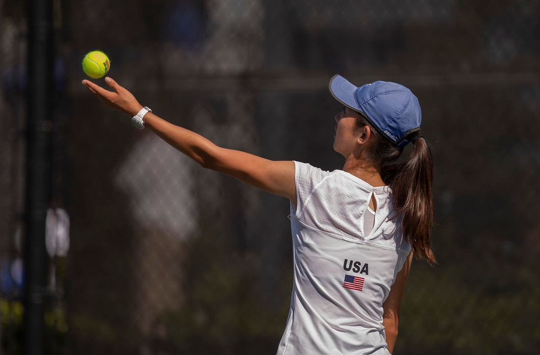 Connie serves in one of her matches. While she enjoys the competition of tennis, Connie also values the relationships she has with her team members and the supportive environment this creates.