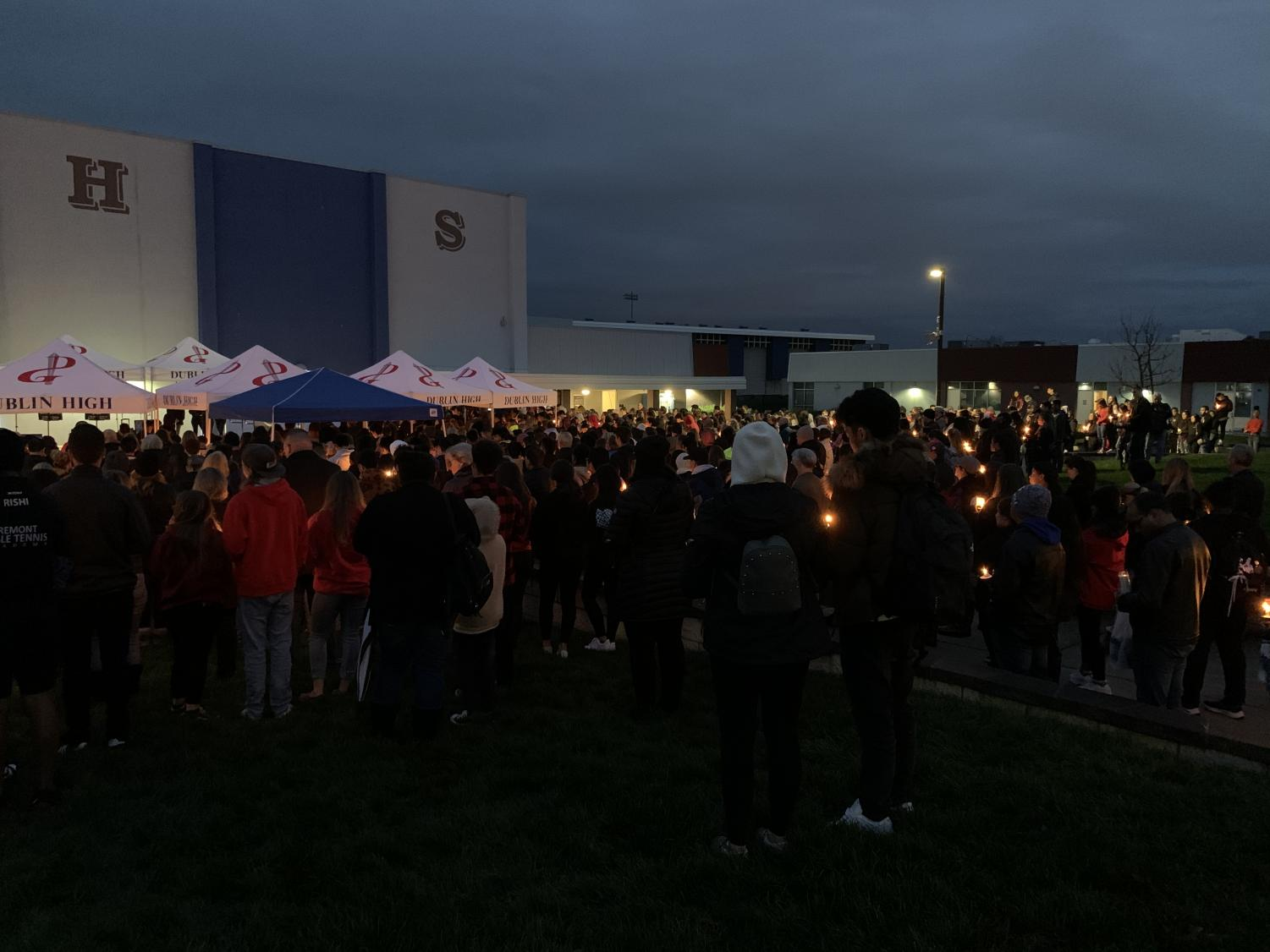 Hundreds of Dublin residents gather at a candlelight vigil in the DHS quad to mourn the loss of these beloved students and provide support to the families.