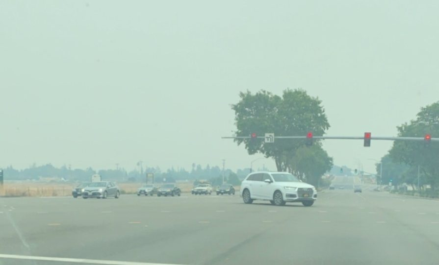 A view from Singh's car reveals an alarmingly smoky scene due to raging wildfires.