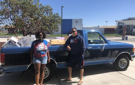 Tripplett and Mr. D'Ambrosio, DHS's Leadership teacher, bring leftover spirit gear to homeless shelters.