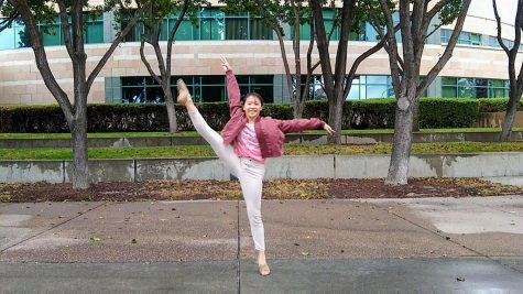 Vivian Tseng performs her dance in front of the Civic Center.